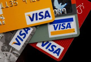 Are credit or debit cards better for vacation?