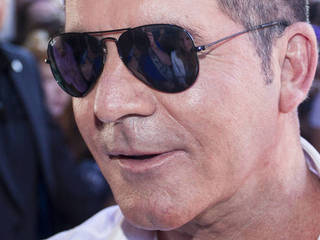 Simon Cowell: 'Gay claim is untrue'