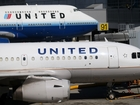 United will charge for use of overhead bins
