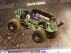 Monster truck Grave Digger flips over