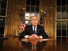 Bush offers muted criticism of Trump