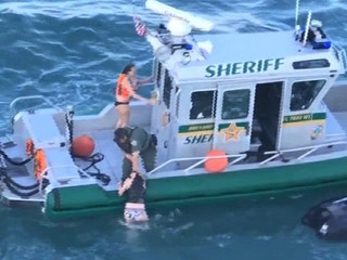 VIDEO: Deputy pulls jet skiers from ship's path