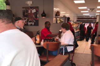 IHOP server helps a disabled woman eat her meal