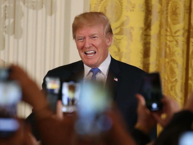 President Trump signs $1.3 trillion budget after threatening veto