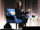 Watch: Obama surprises Michelle on book tour